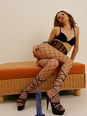 Doll in high heels and fishnets pinches nips and plays toy