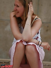 Sitting upskirt. Cutie voyeured in public place