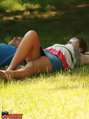 Simply upskirt - she's lying on grass and is being voyeured