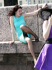 Girl in the park plays with upskirt