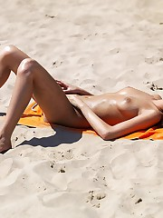 Girls expose nude bodies on beach