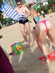 Girls on the beach wear nice bikinis