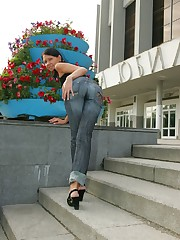 Girl in tight jeans fools around and shows ass in public