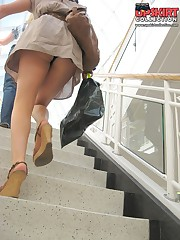 The real upskirt - voyeur blonde in public place upskirt shot