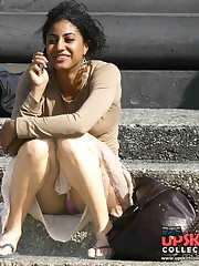 Upskirt of a squatting ebony beauty. Squat upskirt celebrity upskirt