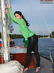 Brunette cutie in tight black pants upskirt photo