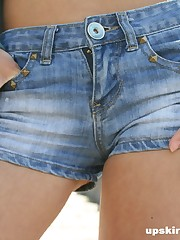 Tiny jeans shorts slid down exposing black string upskirt pic