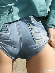 Tiny jeans shorts slid down exposing black string upskirt picture