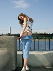Blue fitting jeans of this girl sexily wrap her slim hips upskirt voyeur