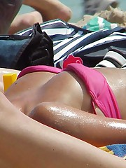 The babes' bikini panties hardly cover their nubs upskirt picture