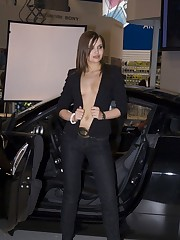 Babe's upblouse gets spied when she poses near the car upskirt shot