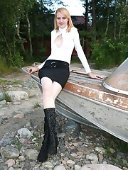 Slim doll in high boots spreads to show fat pussy lips upskirt pic