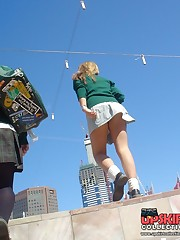 Schoolgirl upskirt - legal teen in green skirt spyed upskirt pic