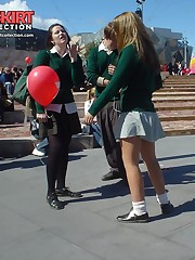 Schoolgirl upskirt - legal teen in green skirt spyed upskirt photo