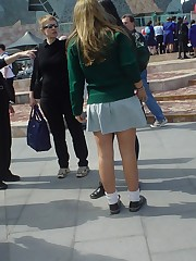 Schoolgirl upskirt - legal teen in green skirt spyed upskirt shot