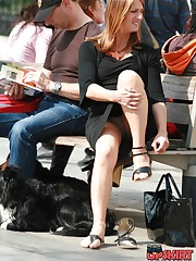 Redhead milf on a bench. Candid sitting upskirt upskirt picture