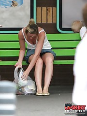 Upskirt sitting - blonde in mini at the bus stop upskirt picture