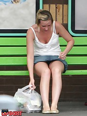 Upskirt sitting - blonde in mini at the bus stop upskirt photo