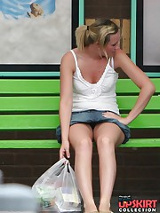 Upskirt sitting - blonde in mini at the bus stop upskirt shot