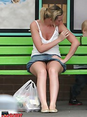 Upskirt sitting - blonde in mini at the bus stop up skirt pic