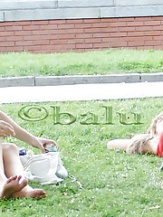 Cute upskirt girls relax in the park up skirt pic