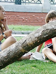 Cute upskirt girls relax in the park upskirt no panties