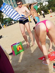 Beach filled with crowd in bikinis upskirt no panties